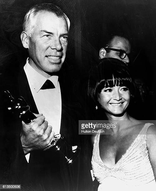 Actor Lee Marvin with his Oscar for Cat Balou with Michelle Triola 1965