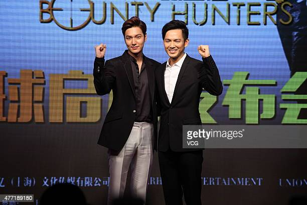 Actor Lee MinHo and actor Wallace Chung attend booting ceremony for film 'Bounty Hunters' on June 14 2015 in Shanghai China