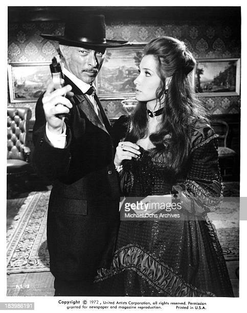 """Actor Lee Van Cleef and actress Annabella Incontrera on set of the United Artists movie """"The Return of Sabata"""" in 1971."""