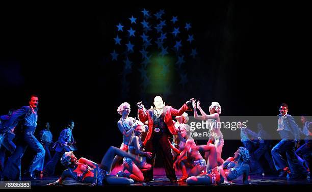 Actor Leo Tavarro performs with dancers during a media call for Miss Saigon at the Lyric Theatre on September 21 2007 in Sydney Australia