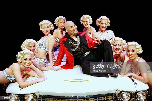 Actor Leo Tavarro poses with dancers during a media call for Miss Saigon at the Lyric Theatre on September 21 2007 in Sydney Australia