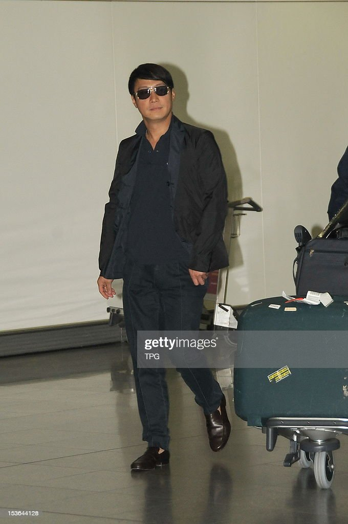 Actor Leon Lai arrives at Hong Kong International Airport on Sunday October 7, 2012 in Hong Kong, China. Lai was surrounded by paparazzi who wanted to know his status after divorce when he arrived.