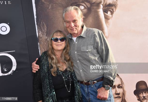 US actor Leon Rippy and his wife Carol Rippy arrive for the Los Angeles premiere of HBO Films' Deadwood at the Cinerama Dome in Hollywood on May 14...