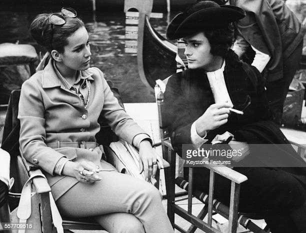 Actor Leonard Whiting in costume as 'Casanova' smoking a cigarette with a friend on the set of the film 'Giacomo Casanova Childhood and Adolescence'...