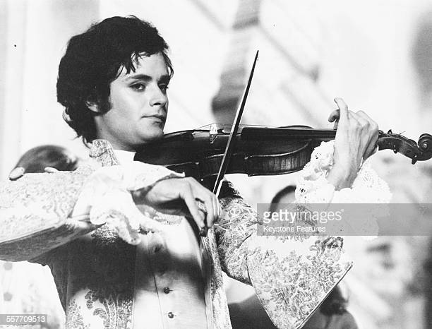 Actor Leonard Whiting playing a violin filming a scene for the film 'Giacomo Casanova Childhood and Adolescence' Rome circa 1968