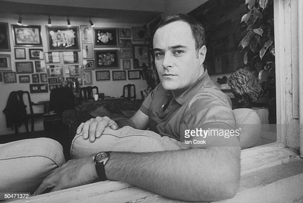 Actor Leonard Whiting relaxing on couch in living room of his Victorian row house in Camden Town