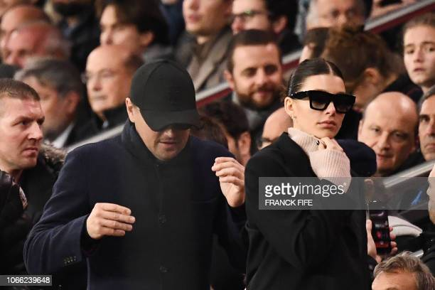 US actor Leonardo Di Caprio and his partner Argentinian and US model Camilla Morrone attend the UEFA Champions League Group C football match between...