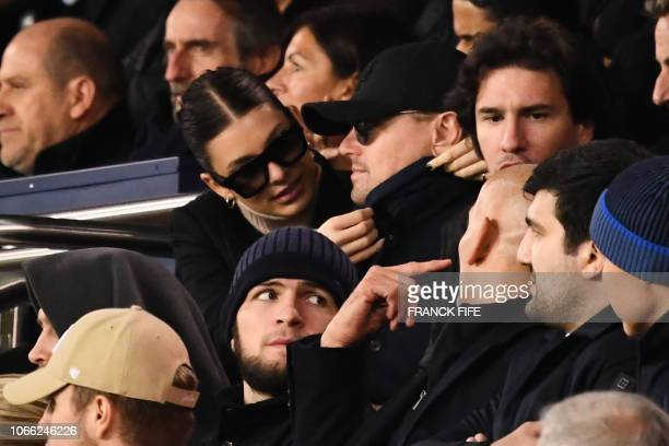 Actor Leonardo Di Caprio reacts as his partner Argentinian and US model Camilla Morrone adjusted his coat's collar while attending the UEFA Champions...