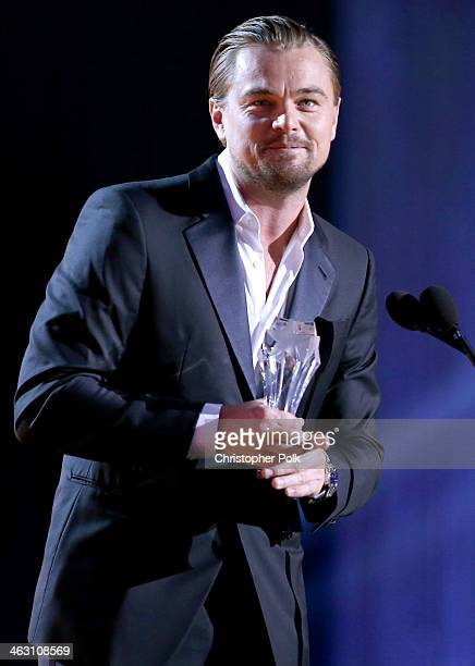 Actor Leonardo DiCaprio accepts the Critics' Choice Award for Best Actor in a Comedy for 'The Wolf of Wall Street' onstage during the 19th Annual...