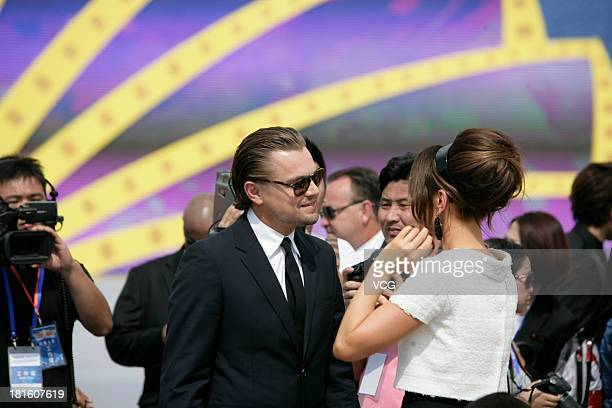 Actor Leonardo DiCaprio and actress Kate Beckinsale attend a launching ceremony for the Qingdao Oriental Movie Metropolis on September 22 2013 in...