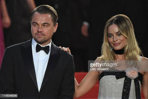 US actor Leonardo DiCaprio and Australian actress Margot Robbie pose before leaving the Festival Palace after the screening of the film Once Upon a...