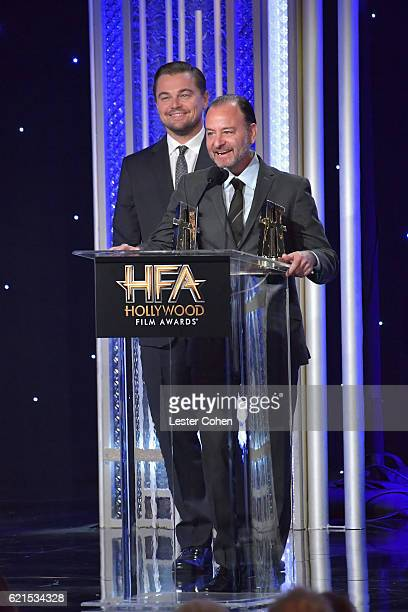 Actor Leonardo DiCaprio and director Fisher Stevens accept the Hollywood Documentary Award for Before the Flood onstage during the 20th Annual...