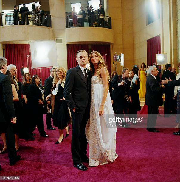 Actor Leonardo DiCaprio and girlfriend supermodel Gisele Bundchen arrive at the 77th Annual Academy Awards® at the Kodak Theatre