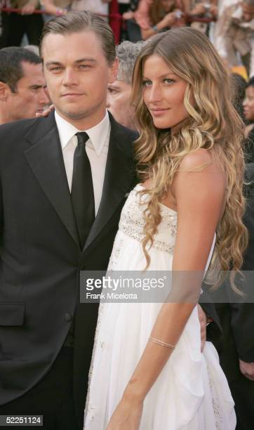 Actor Leonardo DiCaprio and Gisele Bundchen arrive at the 77th Annual Academy Awards at the Kodak Theater on February 27 2005 in Hollywood California