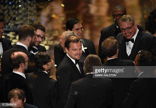 Actor Leonardo DiCaprio and other participants and winners of the 88th Oscars celebrate on stage on February 28 2016 in Hollywood California AFP...