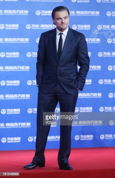Actor Leonardo DiCaprio arrives at the red carpet during the opening night of the Qingdao Oriental Movie Metropolis at Qingdao Beer City on September...