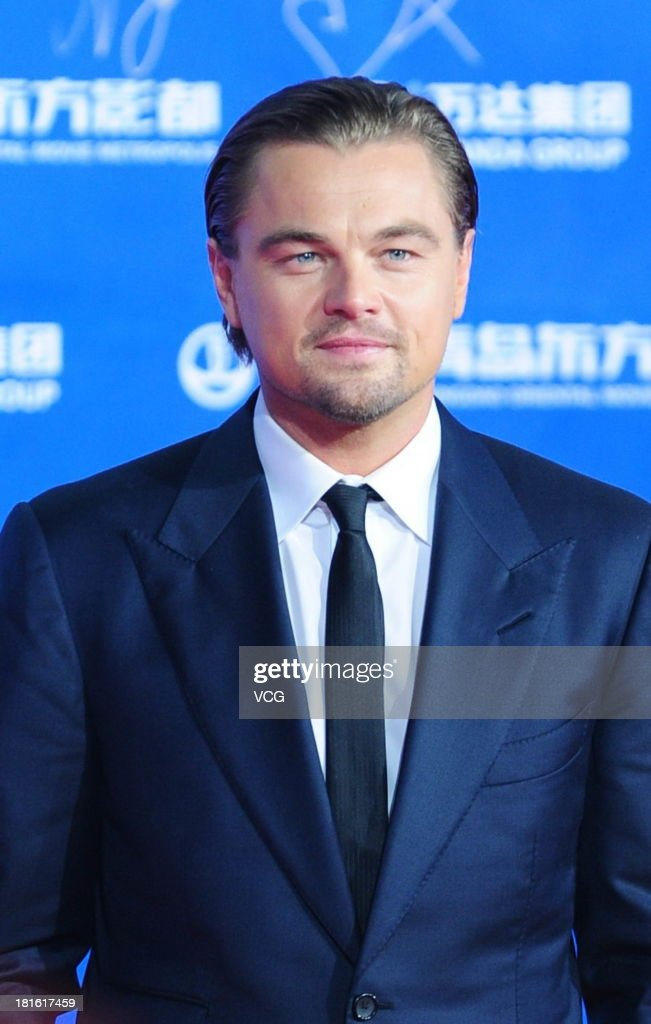 Actor Leonardo DiCaprio arrives on the red carpet during the opening night of the Qingdao Oriental Movie Metropolis at Qingdao Beer City on September 22, 2013 in Qingdao, China.