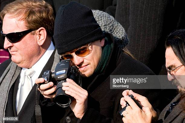 Actor Leonardo DiCaprio center takes photos using a Sony camera during the inauguration ceremony of US President Barack Obama at the Capitol in...
