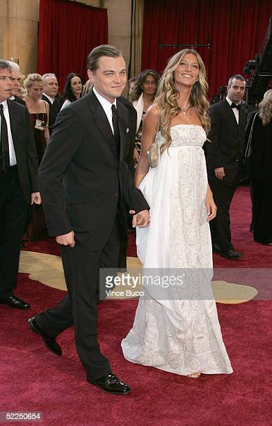 Actor Leonardo DiCaprio nominated for Best Actor for his role in 'The Aviator' arrives with girlfriend Brazilian model Gisele Bundchen at the 77th...