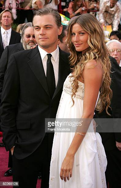 Actor Leonardo DiCaprio nominated for Best Actor for his role in The Aviator arrives with girlfriend Brazilian model Gisele Bundchen at the 77th...