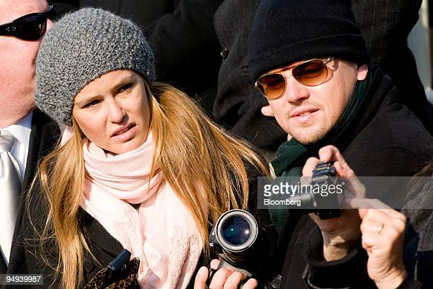 Actor Leonardo DiCaprio right and his girlfriend Bar Refaeli attend the inauguration ceremony of US President Barack Obama at the Capitol in...