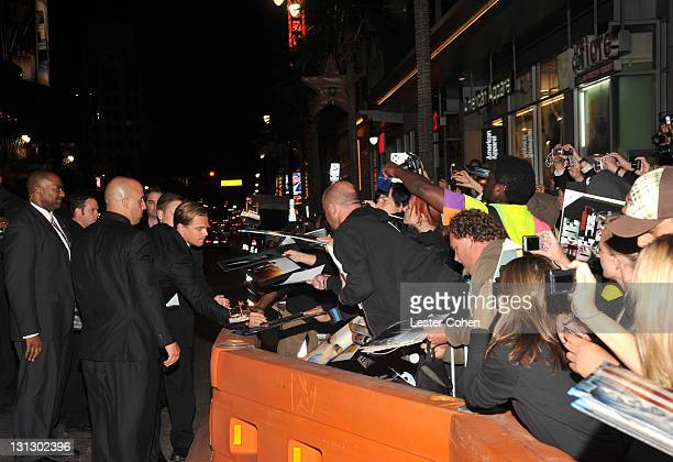 """Actor Leonardo DiCaprio signs autographs as he arrives at the AFI Fest 2011 Opening Night Gala World Premiere Of """"J. Edgar"""" at Grauman's Chinese..."""