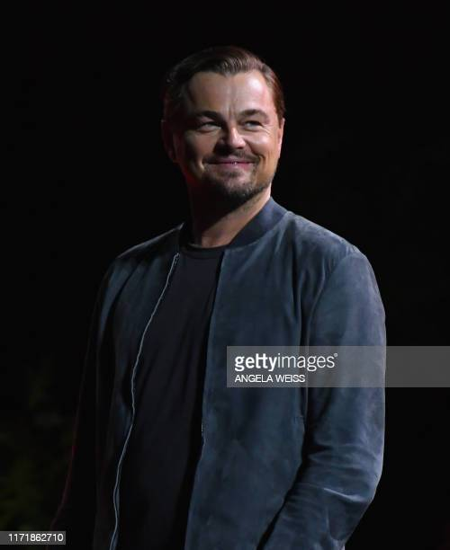 Actor Leonardo DiCaprio smiles as he speaks onstage at the 2019 Global Citizen Festival: Power The Movement in Central Park in New York on September...
