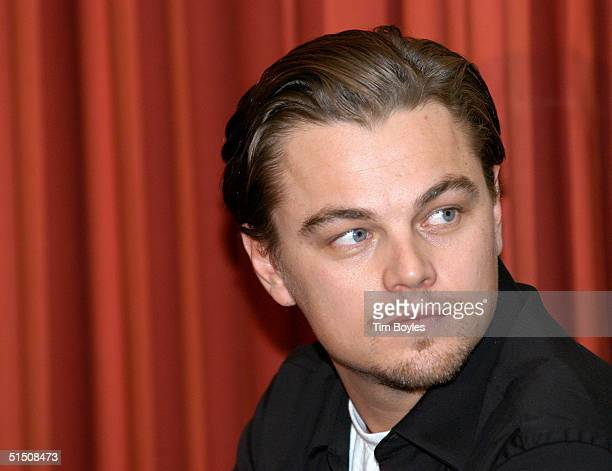 Actor Leonardo DiCaprio waits for his turn to speak to a group of John Kerry supporters October 19 2004 in Tampa Florida DiCaprio told the crowd of...