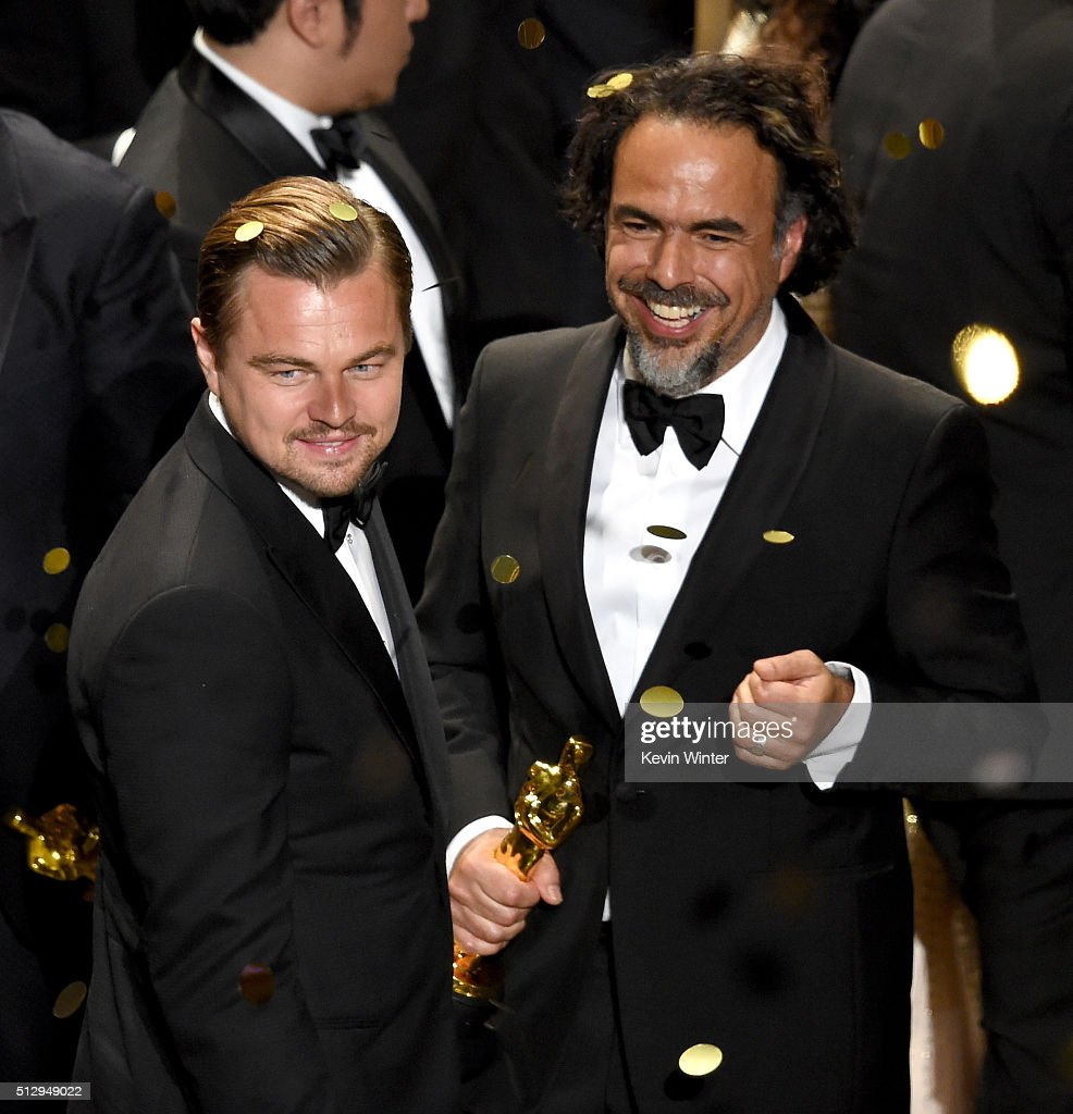 Actor Leonardo DiCaprio (L), winner of Best Actor for 'The Revenant,' and director Alejandro Gonzalez Inarritu, winner of Best Director for 'The Revenant,' celebrate onstage during the 88th Annual Academy Awards at the Dolby Theatre on February 28, 2016 in Hollywood, California.