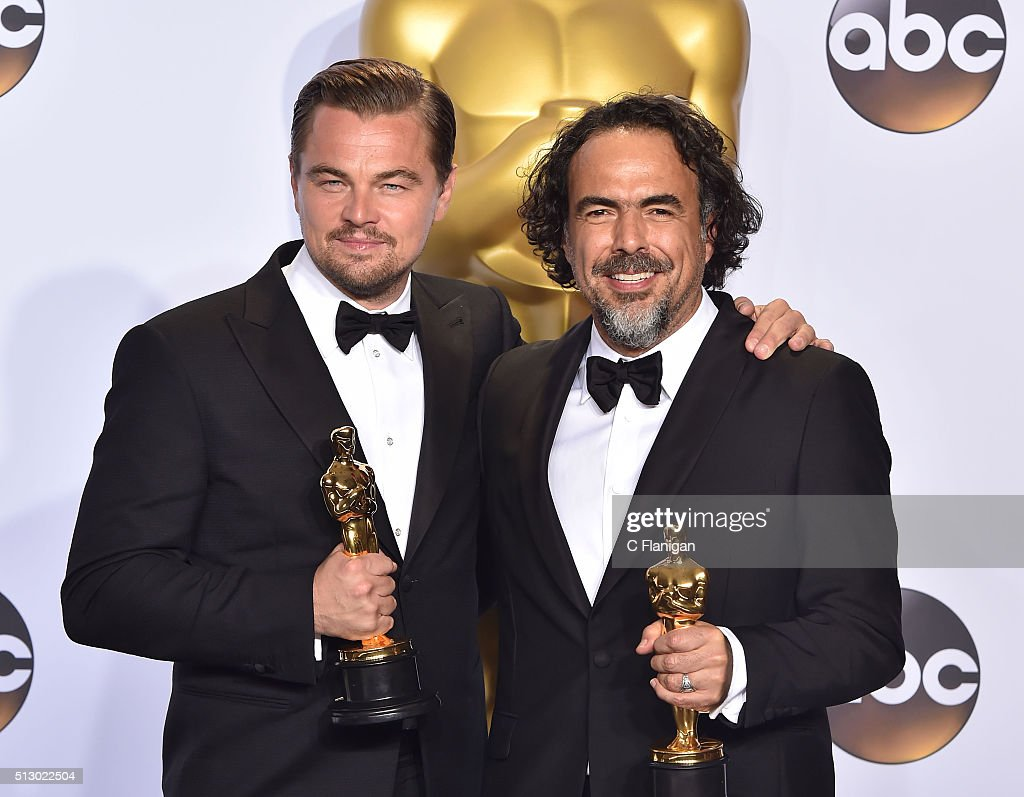 Actor Leonardo DiCaprio (L), winner of the award for Best Actor in a Leading Role for 'The Revenant,' and director Alejandro Gonzalez Inarritu, winner of the Best Director award for 'The Revenant,' posein the press room during the 88th Annual Academy Awards at Loews Hollywood Hotel on February 28, 2016 in Hollywood, California.