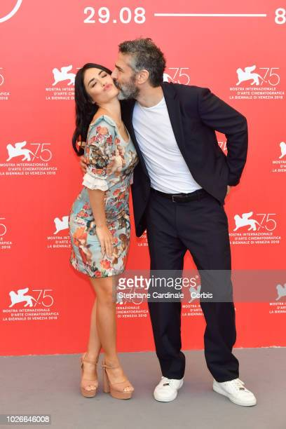 Actor Leonardo Sbaraglia kisses actress Lali Esposito during 'Acusada ' photocall during the 75th Venice Film Festival at Sala Casino on September 4...