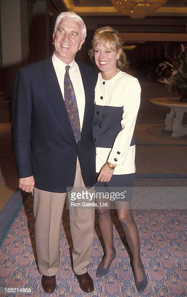 Actor Leslie Nielsen and wife Barbaree Earl attend Mission Hills Celebrity Sports Invitational on November 29 1991 at Rancho Park in Los Angeles...