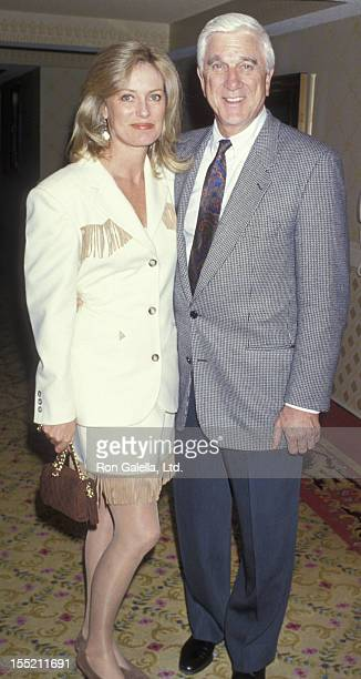 Actor Leslie Nielsen and wife Barbaree Earl attend NATOShoWest Convention on March 8 1993 at Bally's Hotel and Casino in Las Vegas Nevada