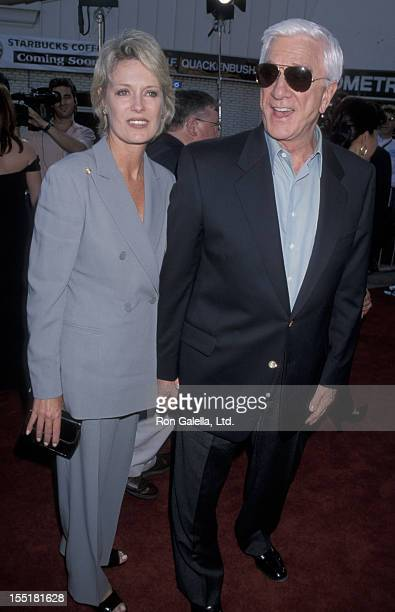 Actor Leslie Nielsen and wife Barbaree Earl attend the premiere of Wrongfully Accused on August 19 1998 at Mann Village Theater in Westwood California