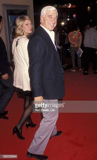 Actor Leslie Nielsen and wife Barbaree Earl attend the premiere of Naked Gun 25 on June 27 1991 at Mann Bruin Theater in Westwood California