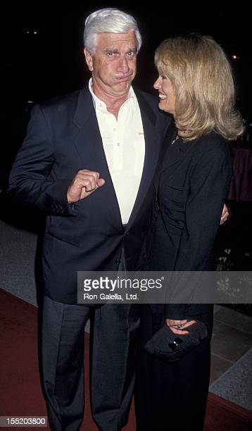 Actor Leslie Nielsen and wife Barbaree Earl attend the premiere of Naked Gun 33 1/3 on March 16 1994 at Paramount Studios in Hollywood California