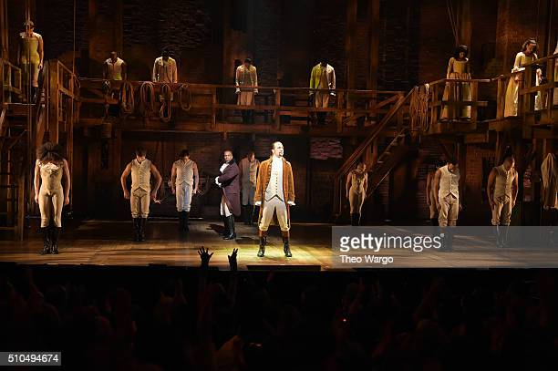 Actor Leslie Odom Jr and actor composer LinManuel Miranda and cast of 'Hamilton' perform on stage during 'Hamilton' GRAMMY performance for The 58th...