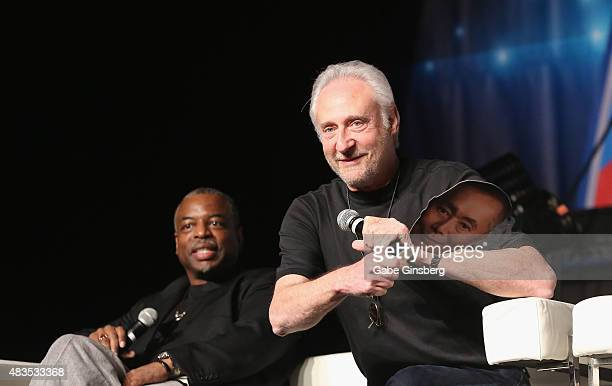 Actor LeVar Burton watches as actor Brent Spiner teases Sir Patrick Stewart with a cardboard cutout of George Takei during the 14th annual official...