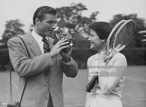 Actor Lex Barker filming tennis player Nancy Chaffee in anticipation of Wimbledon Tennis Tournament at the Hurlingham Club London June 23rd 1950