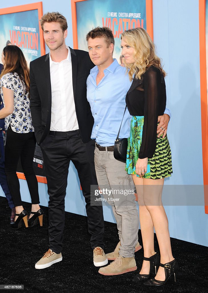 Actor Liam Hemsworth, actor/brother Luke Hemsworth and his wife Samantha Hemsworth arrive at the Premiere Of Warner Bros. 'Vacation' at Regency Village Theatre on July 27, 2015 in Westwood, California.