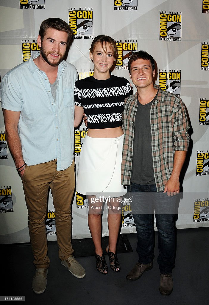 Actor Liam Hemsworth, actress Jennifer Lawrence and actor Josh Hutcherson appear at the Lionsgate preview featuring 'I, Frankenstein' and 'The Hunger Games: Catching Fire' during Comic-Con International 2013 at San Diego Convention Center on July 20, 2013 in San Diego, California.