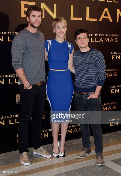 Actor Liam Hemsworth actress Jennifer Lawrence and actor Josh Hutcherson attend the Spanish photocall of the film 'The Hunger Games Catching Fire' at...