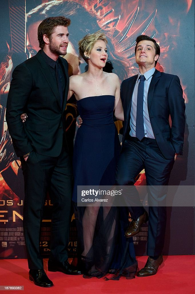 Actor Liam Hemsworth, actress Jennifer Lawrence and actor Josh Hutcherson attend the Spanish premiere of the film 'The Hunger Games - Catching Fire' (Los Juegos Del Hambre: En Llamas) at the Callao cinema on November 13, 2013 in Madrid, Spain.