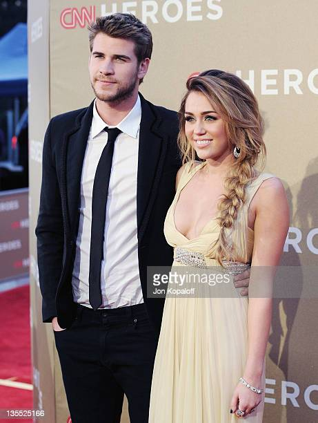 Actor Liam Hemsworth and actress/singer Miley Cyrus arrive at the 2011 CNN Heroes An AllStar Tribute at The Shrine Auditorium on December 11 2011 in...