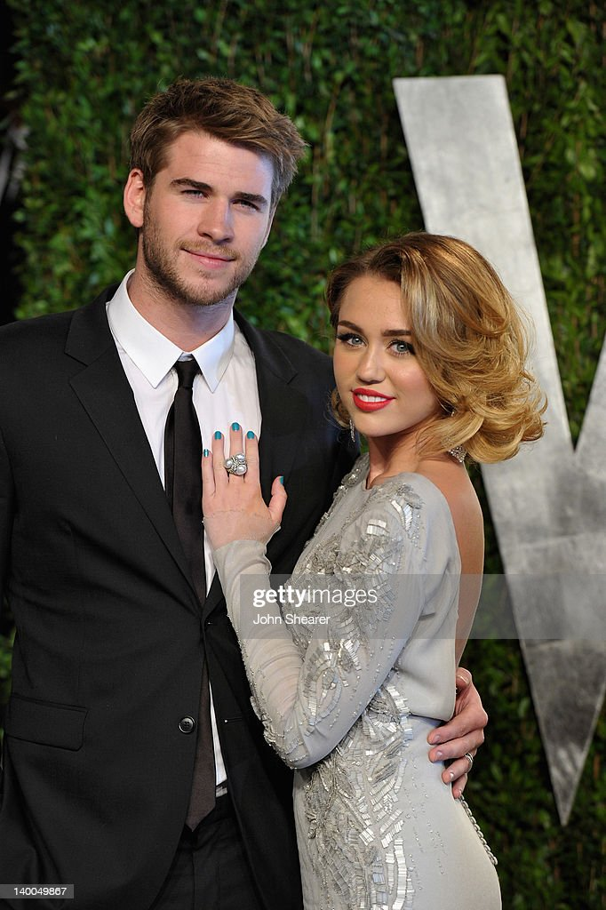 Actor Liam Hemsworth and actress/singer Miley Cyrus arrive at the 2012 Vanity Fair Oscar Party hosted by Graydon Carter at Sunset Tower on February 26, 2012 in West Hollywood, California.