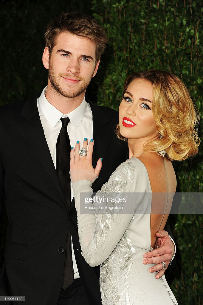 Actor Liam Hemsworth(L) and actress/singer Miley Cyrus arrive at the 2012 Vanity Fair Oscar Party hosted by Graydon Carter at Sunset Tower on February 26, 2012 in West Hollywood, California.