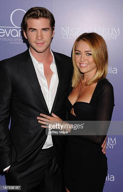 Actor Liam Hemsworth and actress/singer Miley Cyrus arrive at the 8th Annual Australians In Film Breakthrough Awards Benefit Dinner at...