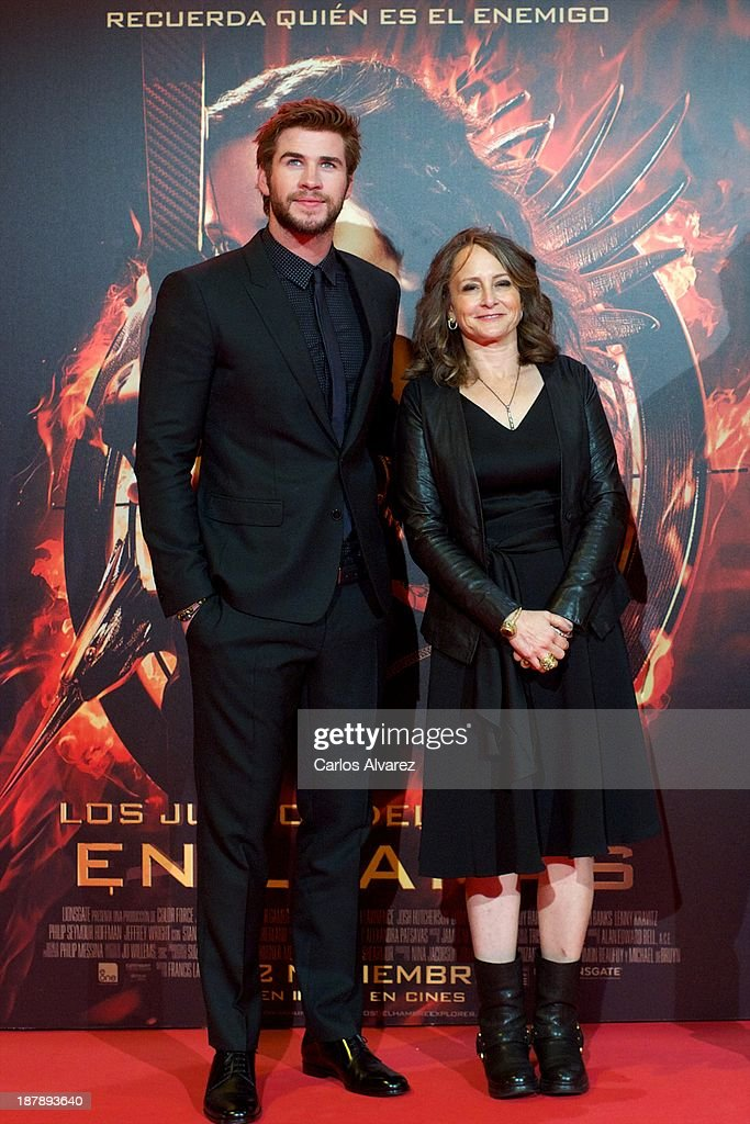 Actor Liam Hemsworth and producer Nina Jacobson attend the Spanish premiere of the film 'The Hunger Games - Catching Fire' (Los Juegos Del Hambre: En Llamas) at the Callao cinema on November 13, 2013 in Madrid, Spain.