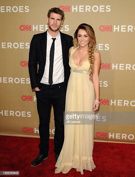 Actor Liam Hemsworth and singer Miley Cyrus arrive at the 2011 CNN Heroes An AllStar Tribute held at The Shrine Auditorium on December 11 2011 in Los...