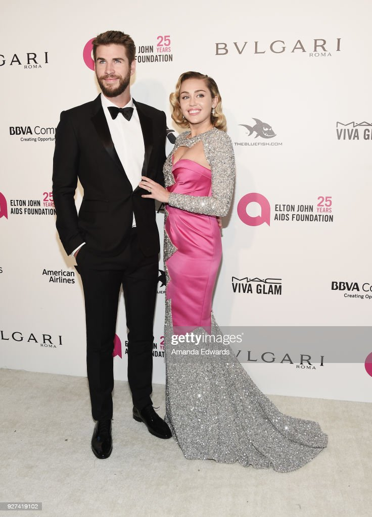 Actor Liam Hemsworth and singer Miley Cyrus arrive at the 26th Annual Elton John AIDS Foundation's Academy Awards Viewing Party on March 4, 2018 in West Hollywood, California.